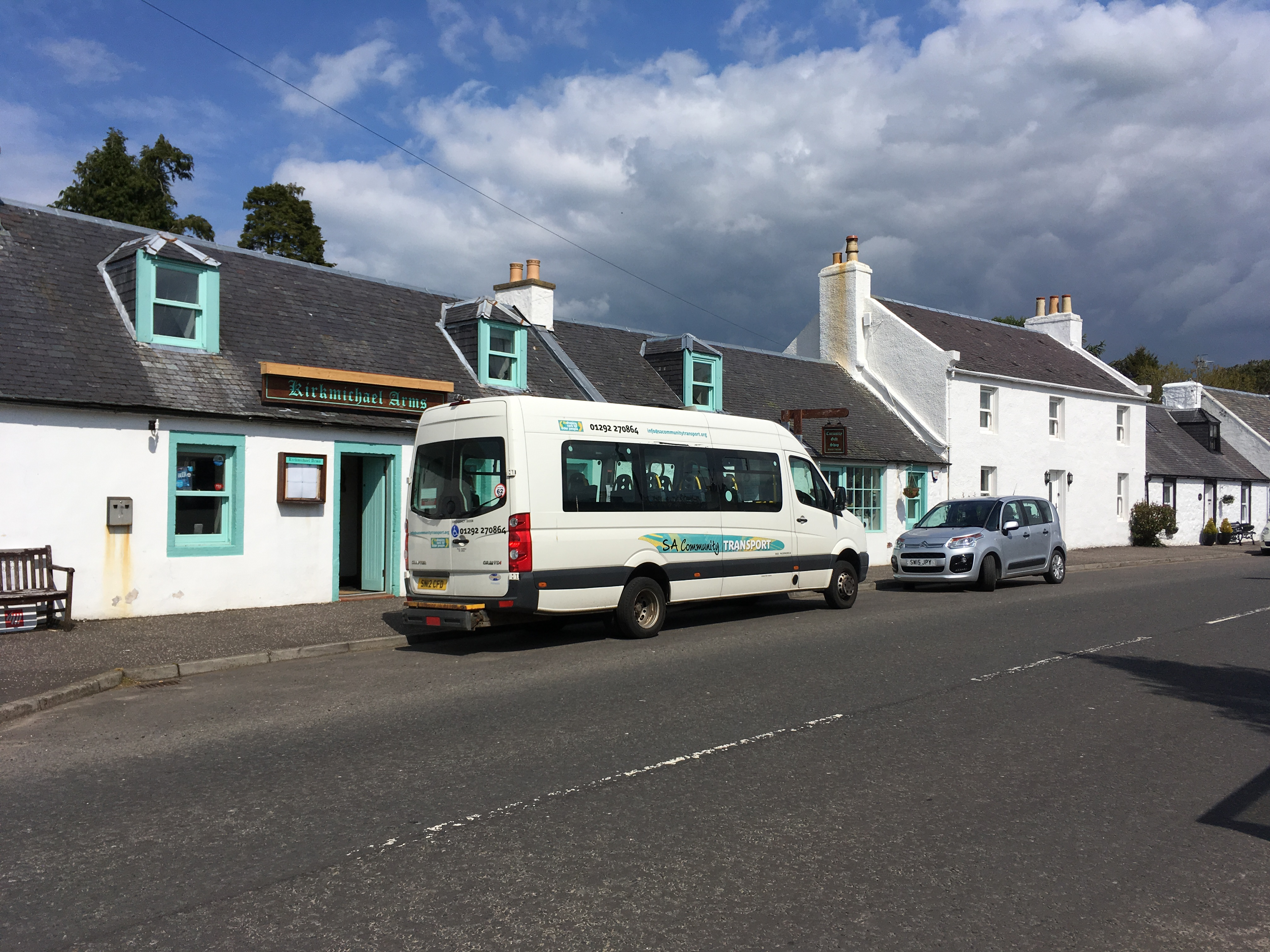 South AyrshireCommunity Transports SACT3 VW Crafter sits on a road outside a restaurant.